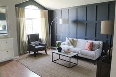 Love this deep navy painted panelling. Bold statement wall. From Chris Loves Julia