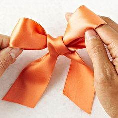 Bows add polish to packages, wreaths, and all kinds of holiday decorating, and these beauties do it with ease. Here's how to make a simple bow that will impress friends and family.