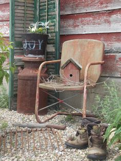 An old pair of boots, a milk can, a bird house on a rusty old chair....