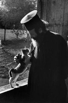 Greek Orthodox priest with cat