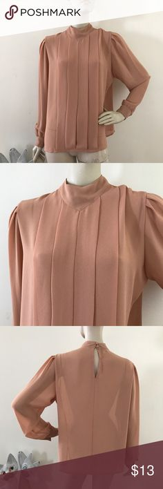 """Vintage 80s Peachy Tan Pleated Poly Crepe Blouse L Vintage 80s Campus Originals blouse  Sheer crepe material, pleated front, Button cuffs, keyhole back  100% polyester  Excellent condition  Size L  Please refer to the measurements for a perfect fit  Shoulders 15.5""""  Sleeves 25""""  Bust 45""""  Waist 41""""  Length 24"""" Vintage Tops Blouses"""