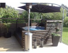 Good idea - shade small pool or spa area with an umbrella (which appears to be set in the concrete) Hot Tub Gazebo, Hot Tub Backyard, Hot Tub Garden, Backyard Pool Landscaping, Backyard Patio Designs, Hot Tub Deck, Jacuzzi Outdoor, Outdoor Spa, Tub Enclosures
