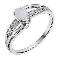 You can have opal engagement ring white gold with the brilliant stones as the one sweetener the opal designed. There are a lot of colors that actually can showed in several colors. The blud white opal ring is ready for everyone who want to seriosly thinking about marriage and you can choose this ring.