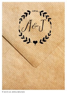 Lovely winter wreath monogram stamp -- the finishing touch for invitations, favor bags, your own stationery and more.