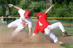 Masconomets Greg Dougherty slides past the tag of Melrose shortstop Jeremy Smith during Mascos 9-0 win on May 30.