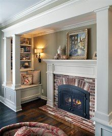 Great idea for built-in nooks surrounding fireplace.  I like that the seating is off to the side and you still get the separate fireplace feel.  The little built-ins seem hidden away.  I like it.