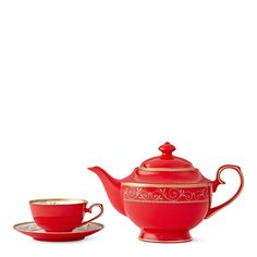 This brilliant red bone china set features a timeless design blending passionate red with a delicate filigree swirl and leaf motif.