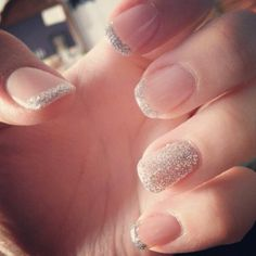 Nude and silver glitter nails.