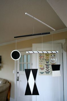 "This item is created with a 60mm (about 2.3"") acrylic ball, card stock, acrylic paint, wooden dowels, wooden ring for hanging, and coated wi..."
