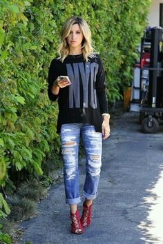 Ashley Tisdale in a rocking outfit.I just love the jeans and the blouse