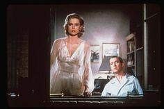 """The 1954 Alfred Hitchcock masterpiece """"Rear Window,"""" starring Jimmy Stewart, Grace Kelly, Thelma Ritter, Wendell Corey, and Raymond Burr, opened 60 years ago. Photo of Kelly and Stewart courtesy of Universal."""