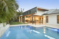 Our North Lakes entertainment area design resulted in a more open-planned approach to the living space at the rear of the home. Moderne Pools, Entertainment Center Wall Unit, Pool Designs, Outdoor Entertaining, Living Spaces, House Styles, Outdoor Decor, Lakes, Australian Homes