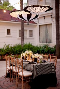 black and white hanging paper lanterns, dotted tablecloth. Night Circus.