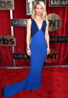 """CLAIRE DANES wears a slinky midnight-and-sky Stella McCartney gown with Tiffany & Co. jewels (including a lapis-and-diamond bracelet about which she said, """"How cool is this bracelet? Don't mess with me!"""")."""