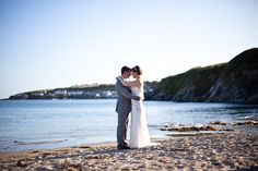 Couple on the beach at Rosevine - it doesn't get more romantic than that. www.rosevineweddings.co.uk