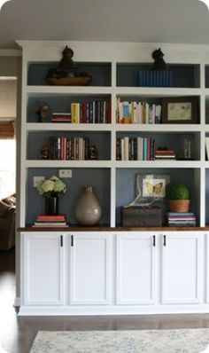 DIY built in bookcases. love the paint in the shelves.