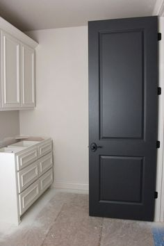 New Home Paint Color. Building a new home requires paint color ideas. Here some great ones to consider: Door paint color: Wrought Iron by Benjamin Moore. Trim and Cabinet Paint Color: Westhighland White by Sherwin Williams. #NewHome #PaintColor Via Timeless Paper.