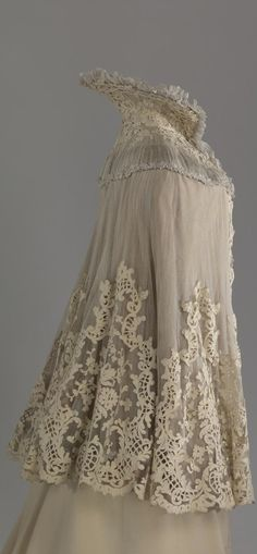 Cape belonging to Empress Alexandra Fyodorovna. Made by the workshop of A. Brisac (?), St. Petersburg, Russia. 1901. Tulle, silk, cloth, soutache, chiffon. Collection of State Hermitage Museum.