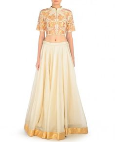 Ivory blouse with zipper detailing on front. Golden bird applique design adorn the kurta. Mandarin collar. Elbow sleeves. Matching lengha with full lining.Wash care: Dry clean