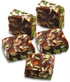 Ingredients: 1 tin condensed milk 1 kg khajur deseeded (dates) 250 gm mixed dryfruits (badam, cashew, pista) cup dessicated dry coconut Method: Break up khajur coarsely Add milkmaid and dryfrui… Indian Dessert Recipes, Indian Sweets, Indian Snacks, Sweets Recipes, Cooking Recipes, Indian Recipes, Vegetarian Recipes, Microwave Recipes, Pizza Recipes