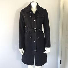 """Laundry by Shelli Segal Long Black Wool Coat Sz M Excellent condition. Worn a few times. True to size. Details: snap button and zipper closure, wait belt, side slit pockets, two faux pockets on chest area, silver-tone button details, contrast knit collar, fully lined. Coat Shell: 57% wool, 26% polyester, 7% viscose, 6% acrylic, 4% other fiber. Knit Trim: 100% acrylic. Lining: 100% polyester. Measurements approximately: sleeves 24.5"""" Coat length (shoulder to bottom hem) 37""""  Armpit to armpit…"""