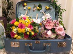 Vintage suitcase and bouquets