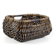 The rectangular shape of the Logger design in softened by curved corners, shown here in the Smoked shade. These baskets work well next to an open fire as part of a traditional rural design scheme, or in more modern rooms accented with natural materials. #HomeDecor