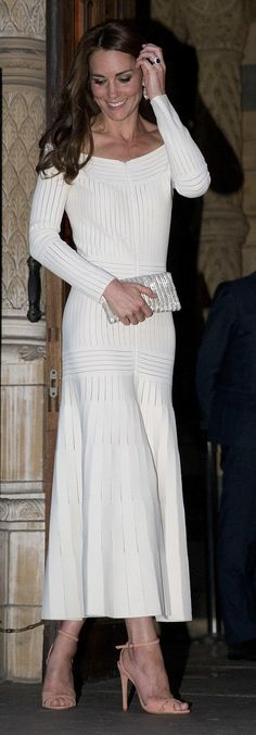 Catherine, Duchess of Cambridge looking stunning in an off shoulder dress by Barbara Casasola, a Brazilian-born, London-based designer.  The mesh paneling added a sporty feel and the long length and pleated skirt gave it more of a regal finish . She really vamped up the look even further with voluminous hair and towering pink suede heels.