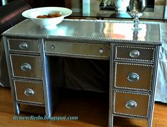 Used aluminum flashing and nailhead trim! ReNew ReDo!: A Stainless Steel Look ~ Desk Redo