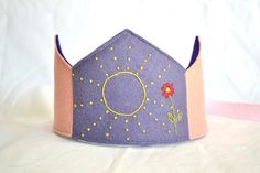 Pink and Purple Dotted Sun and Red Flower Waldorf Wool Felt Birthday Crown. $37.00, via Etsy.