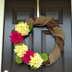 we could do the stick wreath and then add burlap around it.  I like the colors of the flowers