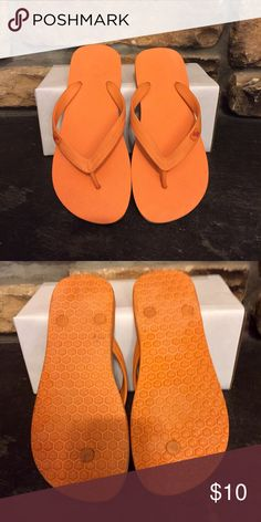A&F Orange flip flops Rubber flip flops with contrast moose on thong. Worn maybe twice, not my color. :) women's size L fits me perfectly and I am a true 9 (like a 9 in Steve Madden.) Abercrombie & Fitch Shoes Sandals