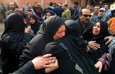 Egyptian women mourn at a morgue in Cairo on February 2, 2012, after 74 people were killed on February 1 at a football match in the northern city of Port Said.