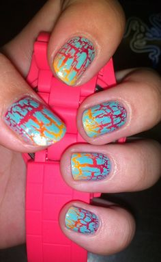 Fire and ice crackle manicure. China Glaze Crushed Candy Crackle over Wet n Wild Red, Orly Terracotta, China Glaze Japanese Koi and CG Sun Worshipper. (via Reddit Lacqueristas)