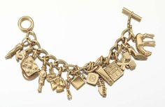 2002 Chanel Charm Bracelet With 16 Iconic Charms | From a unique collection of vintage charm bracelets at http://www.1stdibs.com/jewelry/bracelets/charm-bracelets/