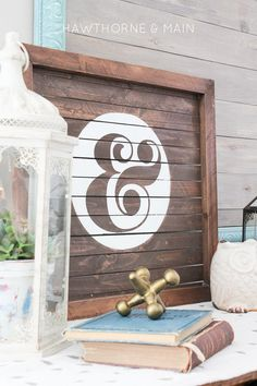 wood slat sign with ampersand painted on it.