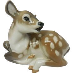 Retired Vintage Royal Copenhagen Porcelain Spotted Fawn Lying Down Figurine.