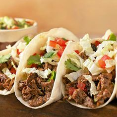 It doesn't have to be Tuesday to enjoy these Skirt Steak Tacos with Guacamole and Lime Crema! More taco recipes: http://www.bhg.com/recipes/ethnic-food/mexican/fuss-free-tacos-tostadas/?socsrc=bhgpin071313steaktacos=6