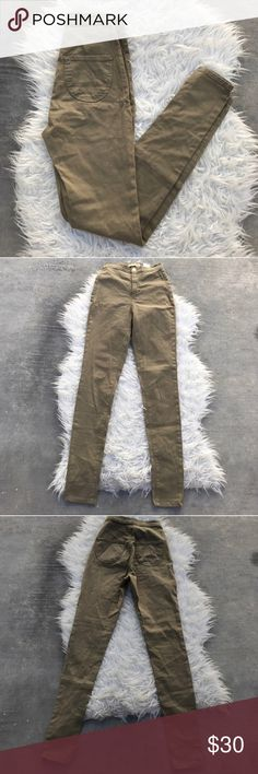 """Olive green high waisted Aphrodite jeans Olive green high waisted skinny jean pants 😍 originally from the brand Aphrodite. Perfect like-new condition!! These remind me A LOT of the American Apparel high waisted easy jeans.  Please do not ask me for a try on. These do not fit me.  Size 5 Measurement around waist is 24"""" and can stretch to fit a 26"""" comfortably.  Length of leg is 43"""" Inseam is 31.5"""" Rise is 11"""" Aphrodite Jeans Skinny"""