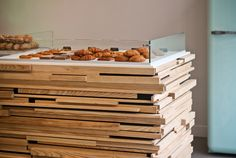 "Custom wood counters from the Brittany-based company Espace Vitrine hold a display of buttery croissants, financiers, tartelettes and mille-feuilles. Siles was inspired by a similar design of multihued ""Jenga"" wood that hung above her bed in a hotel in Thailand. ""Our offering is modern so the last thing we wanted was traditional bakery furniture. We needed something that would be interesting to look at."" Lindsey Tramuta for The New York Times - NYTimes.com"