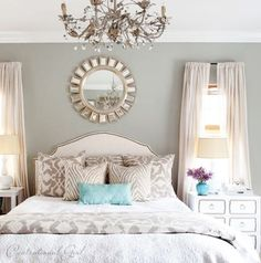 master bedroom - love the wall color, the pop of blue with the pillow and vase, the mixture of pillows, and the mirror above the bed. White Bedroom, Grey And White, Color Pop, Colour Pop, White Bedrooms