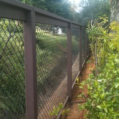 Coated black chain link on painted wood frame - Yelp