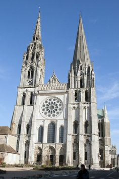 ChartresCathedral,Chartres,France,ca.1145–1155.  The Early Gothic west facade was all that remained of Chartres Cathedral after the fire of 1194. The design still has much in common with Roman- esque facades. The rose window is an example of plate tracery.