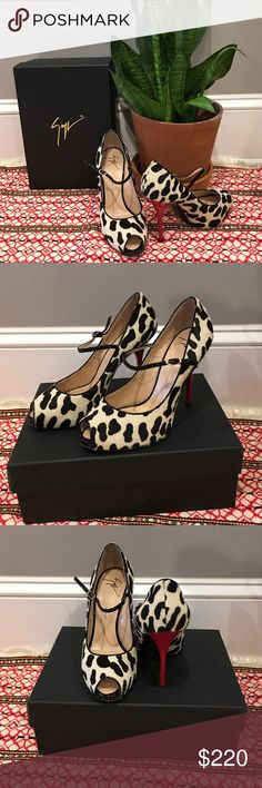 Authentic Giuseppe Zanotti peep-toe pumps Authentic cow print Giuseppe Zanotti pumps with red heal and black patten strap, featuring a small gold buckle. Come with box and dust bag. These are a beautiful statement piece you need in your closet. Only worn twice, mild wear on bottoms. I love these, but I broke my leg and ankle in several places and have not been able to wear high shoes since. Ask me anything! Reasonable offers will be considered. Giuseppe Zanotti Shoes Heels