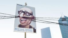 An amusing billboard by Saatchi & Saatchi in Indonesia cleverly advertises the need for nose hair trimmers using electrical wires and poles. Creative, indeed!