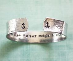 "A bracelet with an encouraging message stamped on the inside: ""A smooth sea never made a skilled sailor."""
