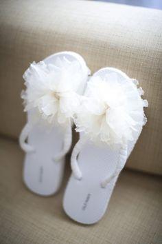 Flowered flip flops a comfy option for the bride.