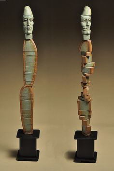 """new004, porcelain and stoneware, rotating, 24""""x4""""x4"""". ClayMaker Ceramics"""