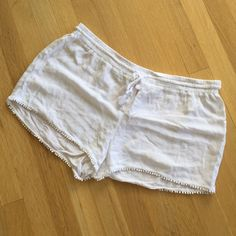 "White pompom lounge shorts Comfy white shorts with little pompom detail :3. Just ended up not wearing much. A little see through- great for a swim suit cover up, pounding or at home or out with nude underwear ;). Some of the elastic is rotated in the waistband. Elastic waist also has drawstring - 34"". Xhilaration Shorts Skorts"