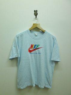 Vintage 90's Nike Swoosh Color Logo T-Shirt by RetroFlexClothing